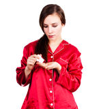 Young woman in red pyjamas taking painkiller Royalty Free Stock Photos