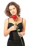 Young woman with red rose. Young beautiful woman with red rose isolated on white background Royalty Free Stock Photography