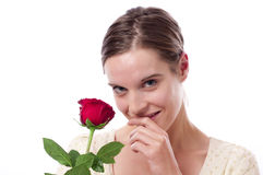 Young woman with red rose Royalty Free Stock Images