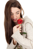 Young woman with red rose Stock Image