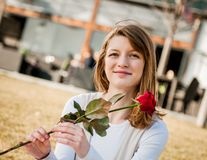 Young woman with red rose Stock Images