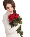 Young woman with red roses Royalty Free Stock Photo
