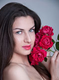 Young woman with red roses Stock Photography