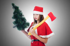 Young woman in red santa costume Stock Photo