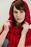 Young woman in a red scarf. Royalty Free Stock Photo