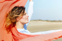 Young Woman With Red Scarf on The Wind Stock Photo