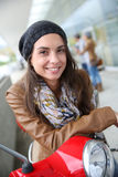 Young woman on red scooter Royalty Free Stock Photo