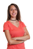 Young woman in a red shirt with crossed arms Royalty Free Stock Photo