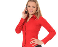 Young woman in red shirt doing phone call Royalty Free Stock Photography