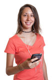 Young woman in a red shirt loves music Royalty Free Stock Image