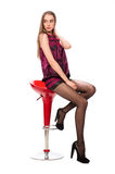 young woman in red sitting on bar chair Royalty Free Stock Photos