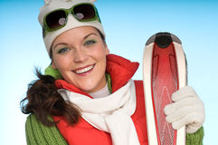 Young woman with red skis Royalty Free Stock Photo