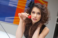 Young woman with red strawberry Stock Photography