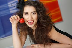 Young woman with red strawberry Royalty Free Stock Photography