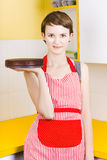 Woman in Red Apron with Chocolate Cake Stock Image