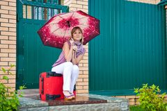 Young woman with a red suitcase Stock Images