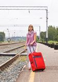 Young woman with a red suitcase Stock Photography