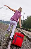 Young woman with a red suitcase Stock Photos