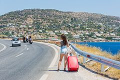 Young woman with red suitcase Royalty Free Stock Photo