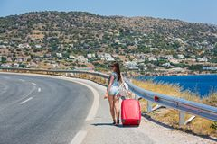Young woman with red suitcase Stock Photo