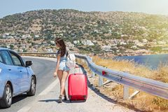 Young woman with red suitcase Royalty Free Stock Image