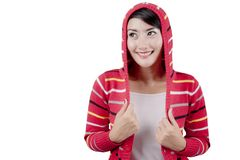 Young woman with red sweater in studio Royalty Free Stock Images
