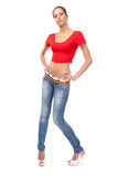 Young woman in a red tee and blue jeans Royalty Free Stock Photos