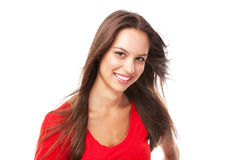 Young woman in a red tee and blue jeans Royalty Free Stock Photography