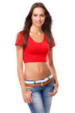 Young woman in a red tee and blue jeans Stock Photo