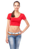 Young woman in a red tee and blue jeans Stock Photos
