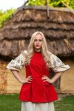 Young woman in red ukrainian national costume. Near old historic house Stock Images