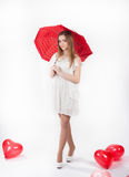 Young woman with red umbrella and balloons. Young woman in white dress with  red  umbrella and heart shaped baloons. Valentine day concept, love concept Royalty Free Stock Photography