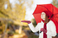 Young woman with red umbrella Royalty Free Stock Photos