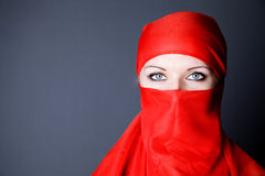 young woman in red veil photo Stock Images