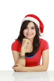 Young woman in red wearing santa hat Royalty Free Stock Photos