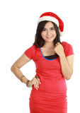 Young woman in red wearing santa hat. Stock Photo