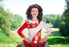 Young woman in red and white irish dance dress and wig posing Stock Photography