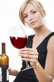 Young woman with red wine. White background Royalty Free Stock Photography