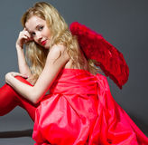 Young woman in red with wings Royalty Free Stock Image