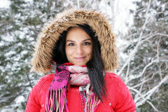 Young woman with red winter coat Royalty Free Stock Images