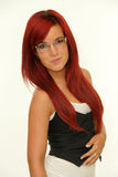 Young woman redhead with glasses Royalty Free Stock Photos