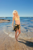 Young woman on reef at sea Royalty Free Stock Photo