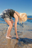 Young woman on reef at sea Royalty Free Stock Image