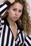Young woman in referee striped shirt Royalty Free Stock Photo