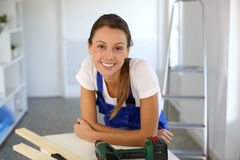 Young woman reforming house. Smiling woman ready to redo home Royalty Free Stock Photo