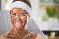 Young woman during refreshing chocolate mask treatment in spa Stock Photography