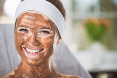 Young woman during refreshing chocolate mask treatment in spa Royalty Free Stock Images