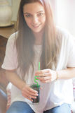 Young woman with refreshing drink Stock Image