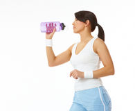 Young woman refreshing after training Stock Image
