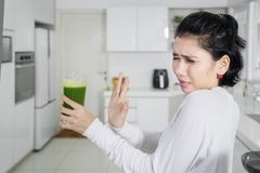Young woman refusing healthy juice Royalty Free Stock Images